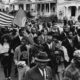 MONTCOMERY, ALA.: Martin Luther King (third form right) leads giant march of Negro and White Civil rights demonstrators here 3/17 to the Montgomery county courthouse to demand an apology for 3/16 use of clubs and horses to break up a racial demonstration.