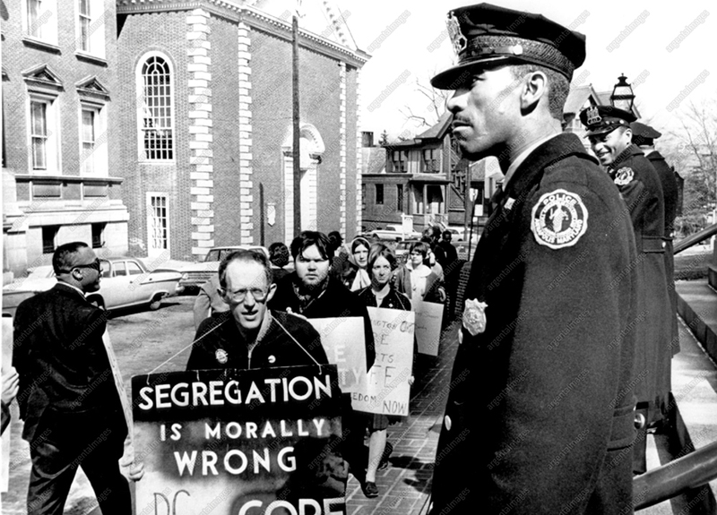 A group of civil rights demonstrators are shown picket! before the Capitol steps,hero 3/2#The group is protesting police tactics during anti-segregation demonstrations in the small Eastern Shore town of Princess Anne last week.