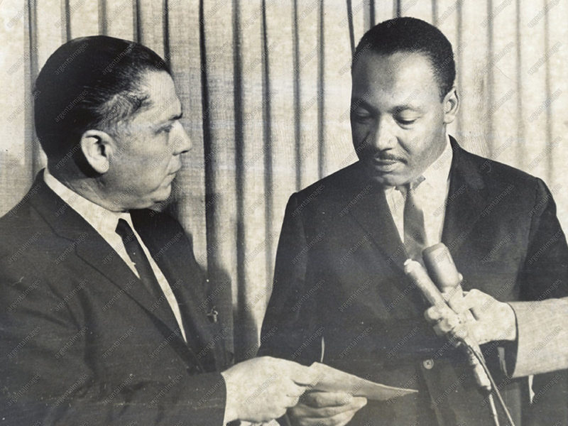 3/30/1965 - Teamsters Union President James R. Hoffa (left) presents a $25,000 check to the Reverend Martin Luther King, Jr., to aid in his civil rights battle. The check, a gift of the Teamsters Union, was presented to King in the funeral home where the body of civil rights worker Mrs. Viola Liuzzo awaited funeral services.
